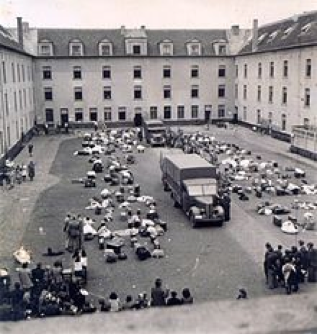 "Mechelen in Belgium: the inner courtyard of the Kazerne Dossin, where after the occupation of the country by the German Wehrmacht, Jews as well as Sinti and Roma were ""collected"" before they were taken to Nazi extermination camps in Auschwitz and other locations. The building is named after a World War I officer who was honoured as a hero in October 1914 for his committent in the Battle of Yser. Meanwhile, here and in an adjacent new building (opened in 2012), places of remembrance and memorial were established."